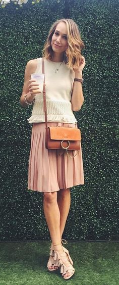 A pleated skirt paired with a sleeveless top.