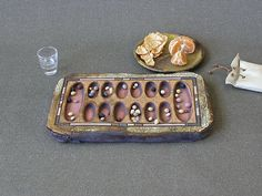 Mancala (Oware) Ancient African game, popular in the entire continent, with many variations and names. It is believed to be one of the oldest games in the world.