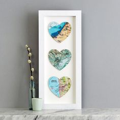 Choose three special map locations for this personalised map anniversary wedding or framed print gift. A unique personalised romantic wedding or anniversary gift. Personalise your art work by choosing three map locations that have special meaning to the person it's for. It makes a wonderful wedding present with many customers choosing maps showing where the bride and groom met, married and where they live together. Your hearts will be hand cut from original maps and atlases from our o...