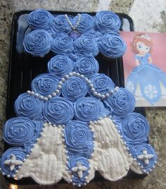 Princess Sophia Cupcake Cake!  Eddible pearls and an upside down heart lollypop for her amulet.