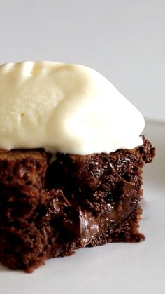 Recipe with video instructions: How to make Nutella Brownies.  Ingredients: 1 ½ cups Nutella, 7 Tbsp butter, 2 eggs, 1/2 cup sugar, 3/4 cup flour, Vanilla ice cream for garnish,