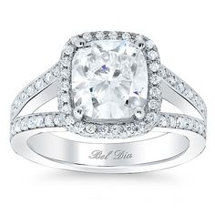 This is the ring but instead of a diamond its a sapphire. (Cushion Cut Halo Engagement Ring with Split Shank.)