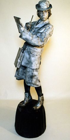 Silver meter maid living statue. Big Foot Events.