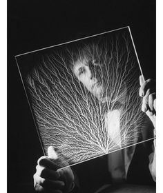 A scientist holds a plastic block that he blasted with charged electric particles while investigating the notion of lightning as a rain trigger, 1962. Image: Fritz Goro—Time & Life Pictures/Getty Images