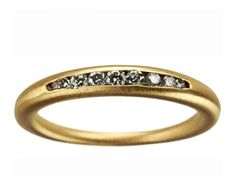 I've been in love with channel-set diamonds ever since I got married. I would so wear this (seems like a great right hand ring!)