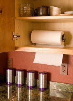 Hidden paper towel holder