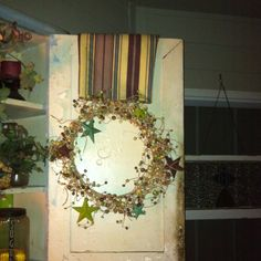 Use wreaths on old furniture doors and layer doors with matching material.