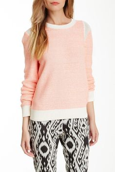 The Mesh Combo Neon Knit Sweater is perfect for a stylish outfit that leaves a bold impression.