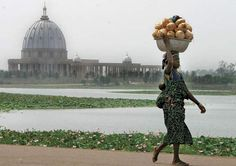 Roman Catholic basilica in Yamoussoukro, Côte d'Ivoire, that is the largest Christian church in the world. The basilica's rapid construction in was ostensibly paid for. Half The Sky, Messy Nessy Chic, High Renaissance, Italy Holidays, Guinness World, Culture, Vatican City, Ivory Coast, Look Alike