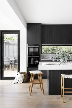 Dark joinery and pops of terrazzo steal the show in this modern home makeover. Terrazzo splashback in kitchen, window splashback in kitchen, black and white kitchen, modern kitchen, built in ovens in kitchen Black Kitchens, Luxury Kitchens, Home Kitchens, Modern Kitchens, Ovens In Kitchens, Kitchen Black, Kitchen Small, Kitchen Oven, Kitchen Dining
