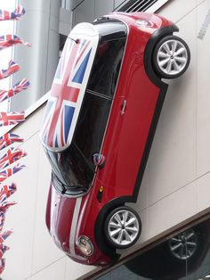 How about purchasing a Union Jack mini cooper?  This one's mounted on a wall as an art installation.  I think it sells it, don't you?  @visitlondon