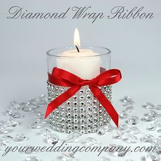 Votive candle decorated with diamond wrap & red ribbon.