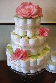 Diaper cake. Would be cuter with black and orange ribbons and pumpkins. =)