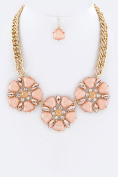 Beautiful statement necklace set featuring jewel flowers. Very versatile to wear. Even better in person! Gold and rosy peach. www.firstandchic.com.