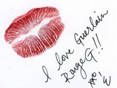 A little Guerlain Rouge G love note. . . Assistant Jewelry Buyer Erica is wearing Gisela, a fiercely bold brick red.(212 872 2734)