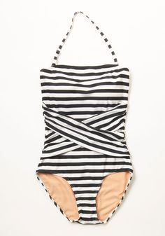 Down for a Dip One-Piece Swimsuit in Black and White. You always save a compartment in your carryall forthis striped swimsuit!Its classic tones of black and white have you set for a swim at any time, and its crisscrossing torso detail makes this lined one piece all the sweeter to wear. #modcloth