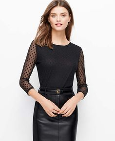 Channel modern allure with this mesh must, divinely dot-sprinkled for pretty polish. Jewel neck. 3/4 sleeves. Exposed back zipper. Shirttail hem. Woven band at neckline and sleeves. Lined body, unlined sleeves.