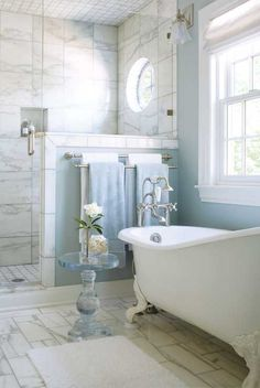 Colorado Homes & Lifestyles - bathrooms - white bath mat, white bath rug, marble tile, marble tiled floors, marble floor tile, calcutta marb...