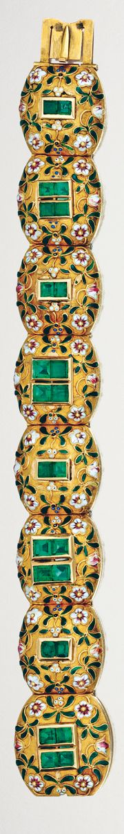 EMERALD, ENAMEL AND GOLD BRACELET, RETAILED BY S. BULGARI,  MID 19TH CENTURY.  Designed as a series of textured yellow gold barrel-shaped links centring on square-cut and cushions-shaped emeralds, embellished by foliate and floral enamelled details,    unsigned, fitted case by S. Bulgari.  length 185mm,