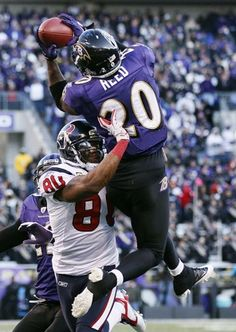 Ravens free safety Ed Reed intercepts a pass intended for Houston Texans wide receiver Andre Johnson during the second half.