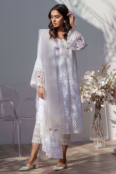 A quintessential Farida Hasan cotton eye-let patchwork shirt with floral embroidery on neckline and sleeves. Comes with a cotton slip. Pakistani Frocks, Pakistani Party Wear Dresses, Simple Pakistani Dresses, Pakistani Dresses Online, Pakistani Fashion Casual, Pakistani Couture, Indian Fashion Dresses, Pakistani Dress Design, Indian Designer Outfits