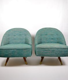 vintage pair of mid century modern green swivel lounge chairs. $700.00, via Etsy.
