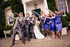 Bridal party posing like Usain Bolt