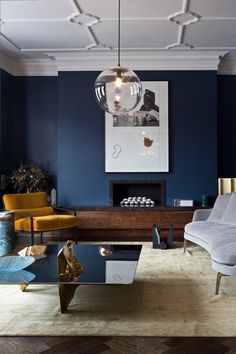 9Interior Decor Living Rooms in Moody Blue. Blue walls, blue sofas, blue ceilings and more! Moody blue living room interiors you'll love! A moody blue living room that is cool (in color and energy) in a Modern Contemporary style. An interesting rounded organic shape for the sofa draws your attention immediately in this space. The…