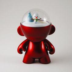 vinyl toy with snow globe
