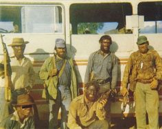 This is a nice reproduction of an original color photograph from the Rhodesian bush war. The photo shows a group of Rhodesian Selous Scouts. The white scouts often painted thier skin black, to appear as colored insurgents from a distance. Military Art, Military History, Military Life, Military Special Forces, Real Steel, Army Uniform, All Nature, Zimbabwe, Warfare