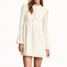 NWT beautiful off white cream mini dress H&M NWT! Off white / natural white /beige mini dress long sleeve, chiffon like material. Bell bottom sleeves. With lace trim. Size 4. Small. $46 free shipping! On Ⓜ️ercari!! Sold out everywhere! Short dress in woven fabric with pin-tucks and lace inserts. Lace-covered stand-up collar, open section at back, and covered buttons at back of neck. Seam at waist and concealed side zip. Lined skirt.  * forever 21 , urban outfitters , ugg , lululemon…