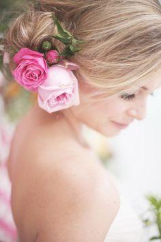 Bridal hair arrangement ... Beautiful roses in blonde hair.