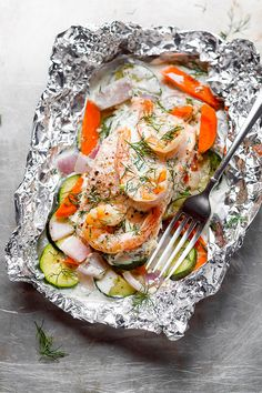Creamy Shrimp and Salmon Foil Packets - Healthy and Delicious, say hello to the easiest way to make salmon in foil packets!