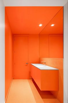 The striking colour of the stairway acts as the focal point of this interior composition, where yellow brings a warm and vibrant tone to the project of @naturehumaine #bathroom #orange