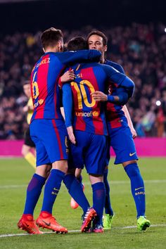 Lionel Messi (C) of FC Barcelona celebrates with his teammates Denis Suarez (L) and Neymar Santos Jr (R) after kicking a penalty shot and scoring his team's second goal during the La Liga match between FC Barcelona and CD Leganes at Camp Nou stadium on February 19, 2017 in Barcelona, Catalonia.