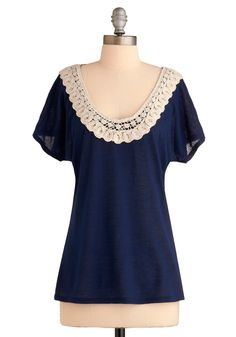 lace scoop neck is a sweet detail.  versatile -- pair with highwaisted skirt/shorts and belt.