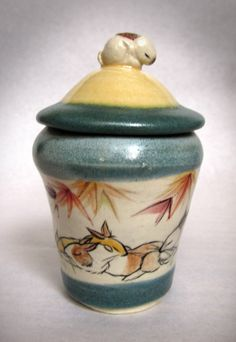 Miniature covered jar with lounging rabbits all around and sculpted sleepy bunny knob. Bunny Rabbits, Knob, Sculpting, Miniatures, Chinese, Jar, Home Decor, Whittling, Decoration Home