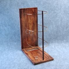 The Ribcage Earring Display Holder - Jewelry Display Holder - Copper Wood Metal - Booth Display - Earring Tree - (hardwood/rosewood). $197.00, via Etsy.