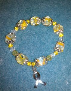Yellow/Gold and white cancer awareness bracelet by BoldenBoutique, $12.00