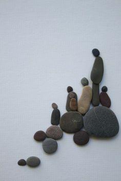 originelle kieselstein dekoration - menschen aus steinen