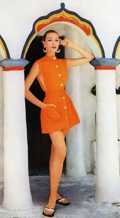 Jessica Ford wears a beach cover-up of tangerine cotton twill by Tom Brigance for Sportmaker and sandals by Bernardo, photo by Louise Dahl-Wolfe in Trinidad, Harper's Bazaar, 1957