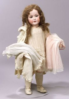 Very Large Cuno & Otto Dressel Bisque Head Doll with Several Original Dresses