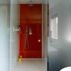 Coloured glass shower wall from colouredglass.co.uk. Does away with the need for maintaining grout.