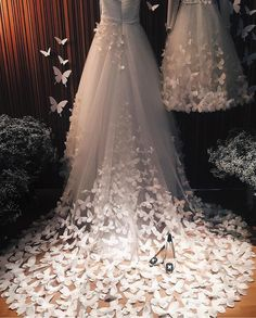 What a stunning gown with 3D butterfly embellishments by speranzacouture.