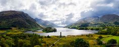 Panoramic view of the Glenfinnan Monument and Loch Shiel in the background in Scotland.