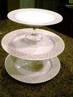 $2 Cookie Display from thrift store plates and parfait or short stemware glue with 'BOND527' cement & allow to dry for 24 hours. hummmm wonder if this cement would work my the red neck wine goblets??   Cleverlyinspired: