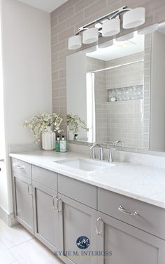 Bathroom remodel, Moen Glyde fixtures, Bianco Drift quartz countertop Caesarstone, subway tile wall, Gray painted vanity by Kylie M Interiors