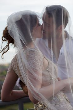 I know this picture is supposed to be about the couple & veil...but look at her dress!!! Gorgeous!