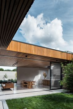 Courtyard House - figr exterior elevation inspiration for house extension. treatment of ceiling panels for house extension