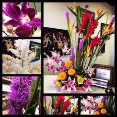 birds of paradise, monkey tail, red ginger, purple liatris, parakeet heliconia, pink celosia, bombay dendrobium, orange marigolds, yarrow and pink stargazer lilies